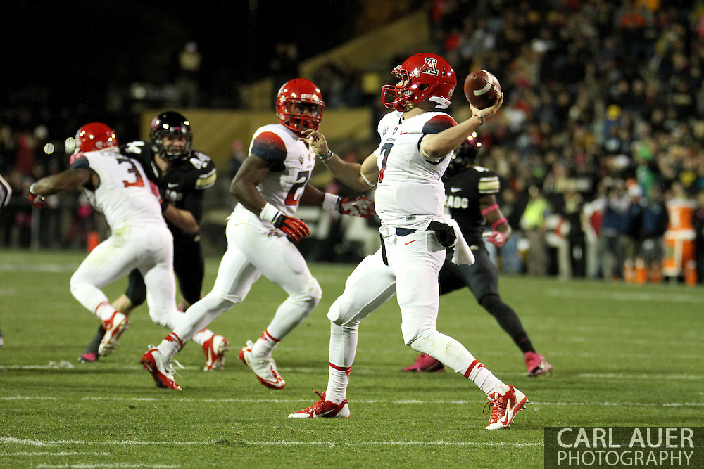 October 26th, 2013:  University of Arizona Wildcats senior quarterback B.J. Denker (7) attempts a pass in the second quarter of the NCAA football game between the University of Arizona Wildcats and the University of Colorado Buffaloes at Folsom Field in Boulder, Colorado