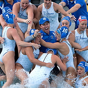 /Andrew Foulk/ For The Californian/ <br /> Members of the Temescal Canyon girls water polo team jump into the pool with their coach Damien Andrew's after their 11-10 overtime victory over Bonita during the CIF Southern Section Division V girls water polo championship match.