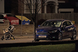 © Licensed to London News Pictures. 14/01/2019. Anerley, UK. A pushchair in the road and a blue car which has a smashed windscreen. A mother has been killed and a child is in hosptial fighting for life after being hit by a car crossing the road in Anerley near Penge.<br />   Photo credit: Grant Falvey/LNP