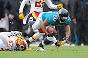 Jacksonville Jaguars wide receiver Mike Thomas (80) is tripped up by Washington Redskins linebacker Lorenzo Alexander (97) during the first half of the Jags game against the Washington Redskins at EverBank Field on Dec. 26, 2010 in Jacksonville, Fl. ©2010 Scott A. Miller