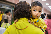 09 OCTOBER 2014 - BANGKOK, THAILAND:  A woman and her child wait to pray in the lobby of Siriraj Hospital for Bhumibol Adulyadej, the King of Thailand. The King has been hospitalized at Siriraj Hospital since Oct. 4 and underwent emergency gall bladder removal surgery Oct. 5. The King is also known as Rama IX, because he is the ninth monarch of the Chakri Dynasty. He has reigned since June 9, 1946 and is the world's longest-serving current head of state and the longest-reigning monarch in Thai history, serving for more than 68 years. He is revered by the Thai people and anytime he goes into the hospital thousands of people come to the hospital to sign get well cards.  PHOTO BY JACK KURTZ