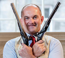 Philip Gregory from Lyon & Turnbull checks over a pair of rare 18th century silver embossed flintlock pistols which are due to be auctioned this week, with a value in excess of £25,000.<br /> <br /> © Dave Johnston/ EEm