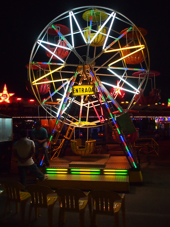 Carnival ride at the summer amusement park in Palamós, Spain, along the Mediterranean coast.