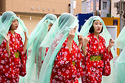 Young women in yukata (summer kimono) in the Tenjin Festival in Osaka.