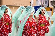 Young women in yukata (summer kimono) in the Tenjin Festival in Osaka.