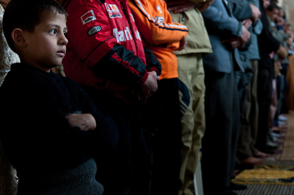 A young boy attends Friday Prayers in the Al Omari Mosque, Gaza City, after the end of Operation Cast Lead.