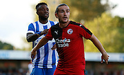 Luke Rooney keeping a close tab on Kasenag LuaLua during the Pre-Season Friendly match between Crawley Town and Brighton and Hove Albion at the Checkatrade.com Stadium, Crawley, England on 22 July 2015. Photo by Michael Hulf.
