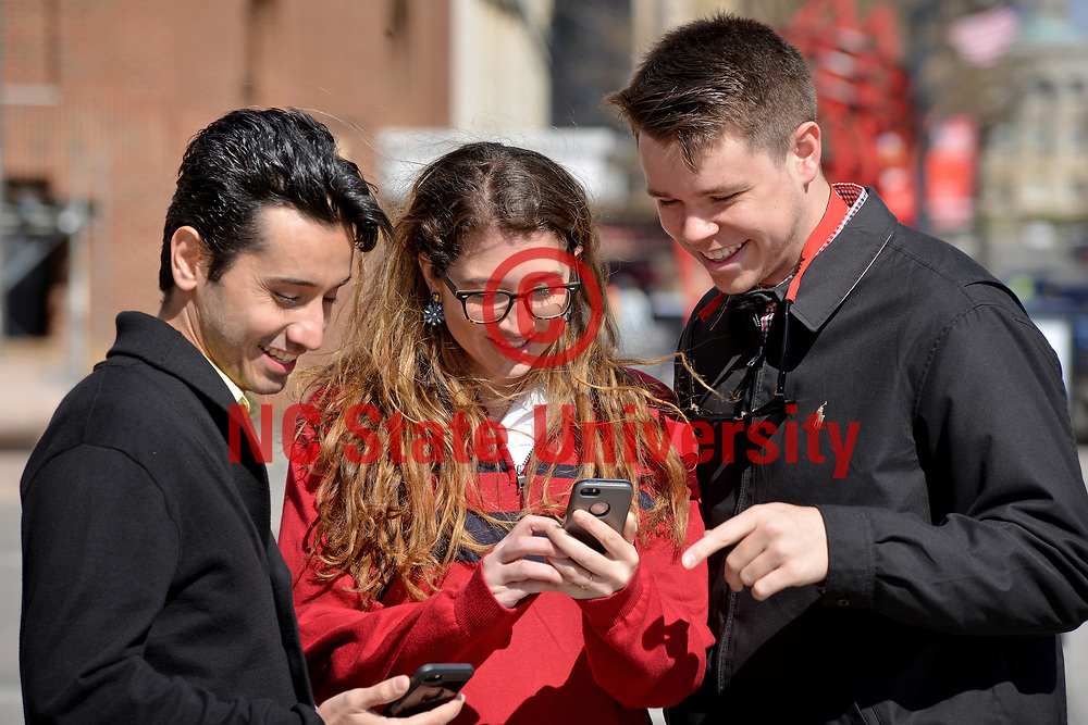 PRTM students check an online map while visiting downtown Raleigh.