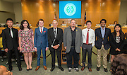 Don Hernandez poses with members of the Bellaire High School debate team during the Board of Trustees meeting, June 11, 2015.