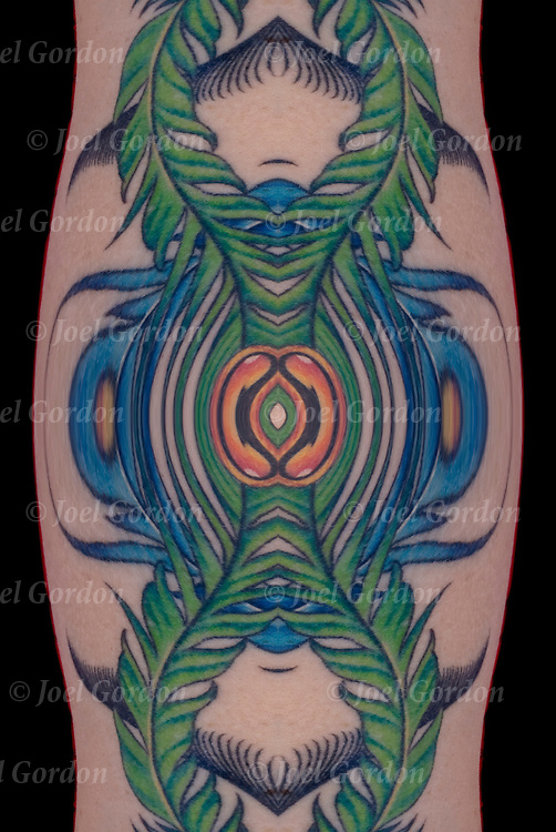 Is this tattoo real or fantasy ? Does it matter? It is up to you the viewer to decide.<br /> <br /> Photographic series of digital computer tattoo art, illusion / fantasy generated from a real tattoo. <br /> <br /> Two or more layers or generations were used to enhance, alter, manipulate the image, creating an abstract surrealistic mirrored symmetry.