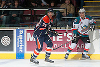 KELOWNA, CANADA - DECEMBER 27: Edson Harlacher D #29 of the Kamloops Blazers is checked by Colton Heffley #25 of the Kelowna Rockets  on December 27, 2013 at Prospera Place in Kelowna, British Columbia, Canada.   (Photo by Marissa Baecker/Shoot the Breeze)  ***  Local Caption  ***