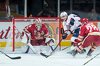 REGINA, SK - MAY 20: Evan Fitzpatrick #31 of Acadie-Bathurst Titan defends the net as Cale Fleury #4 of Regina Pats digs for the puck at the Brandt Centre on May 20, 2018 in Regina, Canada. (Photo by Marissa Baecker/CHL Images)