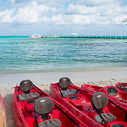 Red Kayaks ready for rent. Rum Point, East End. Grand Cayman Island.