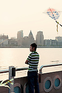 Chinese man overlooks the Bund from Pudong area, Huangpu River, China, Asia, 2011