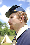 Old Bethpage, New York, USA - July 21, 2012: Life in Camp Scott, a Union Army training camp, is portrayed by Federal Re-enactors wearing authentic military uniforms, at Old Bethpage Village Restoration, to commemorate 150th Anniversary of American Civil War, on Saturday, July 21, 2012.