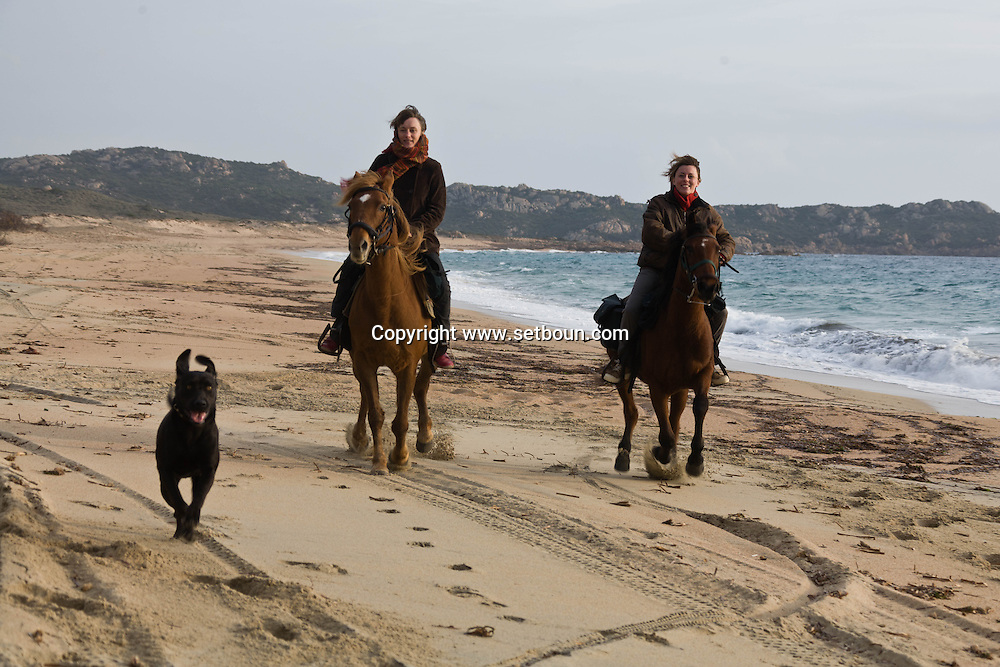 Corsica. France. Horse riding on the beach of Tradicetto , fire and bivouac  Corsica south  France    / randonnee a cheval sur la plage de Tradicetto, feu de camp et bivouac  Corse du sud  France  /