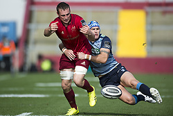 September 30, 2017 - Limerick, Ireland - Tommy O'Donnell of Munster tackled by Tom James of Cardiff during the Guinness PRO14 Conference A Round 5 match between Munster Rugby and Cardiff Blues at Thomond Park in Limerick, Ireland on September 30, 2017  (Credit Image: © Andrew Surma/NurPhoto via ZUMA Press)