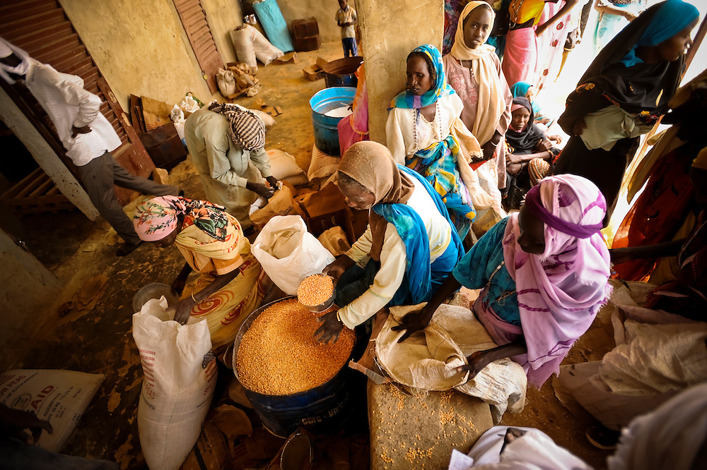 CARE International staff distribute weekly rations to people living in the Iridimi refugee camp near Iriba, in eastern Chad.