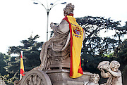 The Cibeles statue with the Spanish Flag