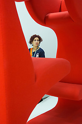 "© Licensed to London News Pictures. 21/10/2013. London, England. A visitor stands behind the sculpture Living Tower by Werner Panton. The Exhibition ""Pop Art Design"" opens at the Barbican Art Gallery/Barbican Centre running from 22 October 2013 to 9 February 2014. The exhibition brings together 200 works by 70 artists and designers including Peter Blake, Andy Warhol and Roy Lichtenstein. Photo credit: Bettina Strenske/LNP"