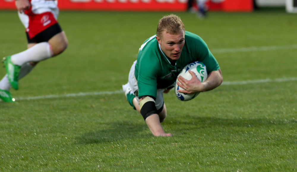 Ireland's Keith Erals goes over the line to score a try against Russia in their Rugby World Cup pool match at Rotorua International Stadium, Rotorua, New Zealand, Sunday, September 25, 2011. Credit:SNPA / John Cowpland
