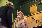 Pippa Evans (centre) is dancing on stage with Sanderson Jones (left) during The Sunday Assembly (today held inside Conway Hall in central London), an atheist service founded by British comedians Sanderson Jones and Pippa Evans in 2013, in London, England. The gathering is designed to bring together non-religious people who want a similar communal experience to a religious church. Satellite assemblies have been established in over 30 cities including New York, San Diego, and Dublin.