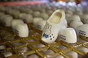 Kleine klompjes als souvenir. Produktie bij de grootste klompenfabriek ter wereld, Klompenfabriek Nijhuis B.V. in Beltrum. Voor de productie van klompen worden speciale en zelf ontwikkelde machines gebruikt. Hoewel het principe al erg oud is, worden de productietechnieken nog steeds verbeterd.<br /> <br /> Little wooden shoes for decoration. Production at the biggest manufacturer of wooden shoes, Klompenfabriek Nijhuis B.V. at Beltrum (NL). For the production special and self developed machines are used. Although the principe of the manufacturing is very old, the techniques are still being improved.