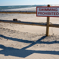 Swimming prohibited sign displayed in the Holgate section of beach in Long Beach Island New Jersey, USA