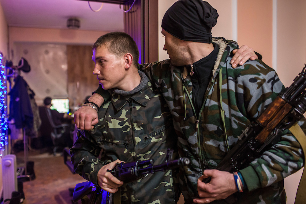 PERVOMAISK, UKRAINE - NOVEMBER 20, 2014: Petr Khokhlov, left, a member of the First Cossack Regiment Named Platov of the Great Don Army, poses for a portrait with Zhenya Gritzan, another member of the regiment, at the dormitory where they are stationed in Pervomaisk, Ukraine. CREDIT: Brendan Hoffman for The New York Times