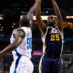 December 17, 2010; New Orleans, LA, USA; Utah Jazz center Al Jefferson (25) shoots over New Orleans Hornets center Emeka Okafor (50) during the first half at the New Orleans Arena.  Mandatory Credit: Derick E. Hingle