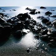 Moonlit rocks on the beach near Fushigoe no Hana in Kochi prefecture in Shikoku, Japan.