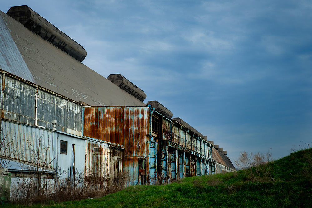 The bar mill building is one of the last structures that remain on the former 178-acre LTV site in Hazelwood near Pittsburgh, Pa. The steel building is seven stories tall and a third of a mile long. <br /> <br /> The mill shut down in the late 1990s, and in 2002, was bought by RIDC and a group of local foundations &mdash; including the Heinz Endowments and Richard King Mellon Foundation &mdash; intent on reclaiming the land for the city and community.<br /> <br /> The Almono partnership &mdash; including the Heinz Endowments and Richard King Mellon and Claude Worthington Benedum foundations &mdash; is preparing the LTV property for $1.3 billion in offices, light manufacturing and housing. They plan on using the bar mill as a centerpiece to the property.