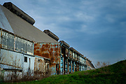 The bar mill building is one of the last structures that remain on the former 178-acre LTV site in Hazelwood near Pittsburgh, Pa. The steel building is seven stories tall and a third of a mile long. <br /> <br /> The mill shut down in the late 1990s, and in 2002, was bought by RIDC and a group of local foundations — including the Heinz Endowments and Richard King Mellon Foundation — intent on reclaiming the land for the city and community.<br /> <br /> The Almono partnership — including the Heinz Endowments and Richard King Mellon and Claude Worthington Benedum foundations — is preparing the LTV property for $1.3 billion in offices, light manufacturing and housing. They plan on using the bar mill as a centerpiece to the property.