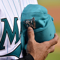 Jun 8, 2018; Miami, FL, USA; Miami Marlins manager Don Mattingly (8) holds his 25th Marlins alumni baseball cap during the national anthem before a game against the San Diego Padres at Marlins Park. Mandatory Credit: Steve Mitchell-USA TODAY Sports