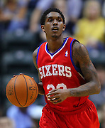 March 14, 2012; Indianapolis, IN, USA; Philadelphia 76ers point guard Lou Williams (23) brings the ball up court against the Indiana Pacers at Bankers Life Fieldhouse. Indiana defeated Philadelphia 111-94. Mandatory credit: Michael Hickey-US PRESSWIRE