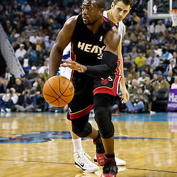 November 5, 2010; New Orleans, LA, USA; Miami Heat shooting guard Dwyane Wade (3) drives past New Orleans Hornets power forward Jason Smith (14) during the first half at the New Orleans Arena. The Hornets defeated the Heat 96-93. Mandatory Credit: Derick E. Hingle