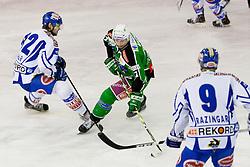 Petr Sachl (HDD Tilia Olimpija, #12) vs Craig Weller (EC Rekord Fenster VSV, #12) during ice-hockey match between HDD Tilia Olimpija and EC Rekord Fenster VSV in 38th Round of EBEL league, on Januar 6, 2012 at Hala Tivoli, Ljubljana, Slovenia. (Photo By Matic Klansek Velej / Sportida)