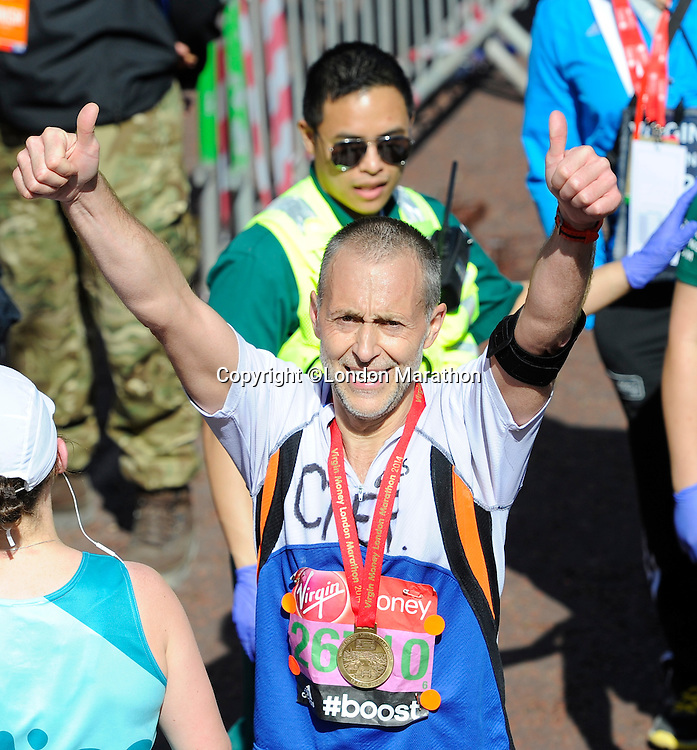Michel Roux Junior at the finish<br /> The Virgin Money London Marathon 2014<br /> 13 April 2014<br /> Photo: Javier Garcia/Virgin Money London Marathon<br /> media@london-marathon.co.uk
