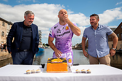 Jack Yeandle joins directors from SW Comms to cut a cake to commemorate their 25 Year Anniversary at Exeter Quay as Exeter Chiefs players row Dragon Boats down the Quay wearing the new Home and European Kits for the 2019/20 Season - Ryan Hiscott/JMP - 19/07/2019 - SPORT - Exeter Quay - Exeter, England - Exeter Chiefs Kit Launch