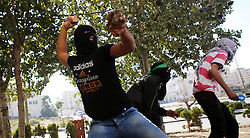 16.10.2015, Ramallah, PSE, Gewalt zwischen Palästinensern und Israelis, im Bild Zusammenstösse zwischen Palästinensischen Demonstranten und Israelischen Sicherheitskräfte // Palestinian protesters throw stones towards Israeli security forces during clashes near the Beit El settlement on the outskirts of Ramallah in the West Bank. The unrest that has engulfed Jerusalem and the occupied West Bank, the most serious in years, has claimed the lives of 34 Palestinians and seven Israelis. The tension has been triggered in part by Palestinians' anger over what they see as increased Jewish encroachment on Jerusalem's al-Aqsa mosque compound, Palestine on 2015/10/16. EXPA Pictures © 2015, PhotoCredit: EXPA/ APAimages/ Shadi Hatem<br /> <br /> *****ATTENTION - for AUT, GER, SUI, ITA, POL, CRO, SRB only*****