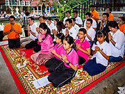 05 JANUARY 2019 - MINBURI, BANGKOK, THAILAND:  SUDARAT KEYURAPHAN (center, pink blouse, pink skirt), the Pheu Thai Party candidate for Prime Minister of Thailand, and other supporters of the Pheu Thai Party pray before monks collected alms at the Kwan Riam Floating Market at Wat Bamphen Nuea in Minburi, east of downtown Bangkok. The Thai government has tentatively scheduled a general election for 24 February 2019. It will be Thailand's first election since a military coup overthrew the government of Yingluck Shinawatra in 2014. Yingluck was a the leader of the Pheu Thai Party before her ouster. Sudarat was a member of Thaksin Shinawatra's cabinet. Thaksin's government was also deposed by a coup in 2006.      PHOTO BY JACK KURTZ