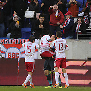 Peguy Luyindula, New York Red Bulls, is lifted by team mate Luis Robles after scoring a 94th minute equalizer during the New York Red Bulls V Chivas USA, Major League Soccer regular season match at Red Bull Arena, Harrison, New Jersey. USA. 30th March 2014. Photo Tim Clayton