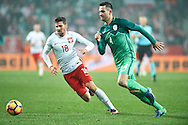 Wroclaw, Poland - 2016 November 14: (L) Pawel Wszolek of Poland fights for the ball with (R) Miral Samardzic of Slovenia during Poland v Slovenia - International Friendly Soccer Match at Municipal Stadium on November 14, 2016 in Wroclaw, Poland.<br /> <br /> Adam Nurkiewicz declares that he has no rights to the image of people at the photographs of his authorship.<br /> <br /> Picture also available in RAW (NEF) or TIFF format on special request.<br /> <br /> Any editorial, commercial or promotional use requires written permission from the author of image.<br /> <br /> Mandatory credit:<br /> Photo by © Adam Nurkiewicz / Mediasport