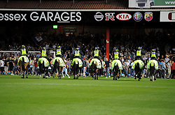 Police horses head on to the pitch to stop the fans clashing   - Photo mandatory by-line: Joe Meredith/JMP - Tel: Mobile: 07966 386802 04/09/2013 - SPORT - FOOTBALL -  Ashton Gate - Bristol - Bristol City V Bristol Rovers - Johnstone Paint Trophy - First Round - Bristol Derby