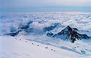 Climber rest on their way up Mt Rainier in Washington. Trip taken May 1999.<br />