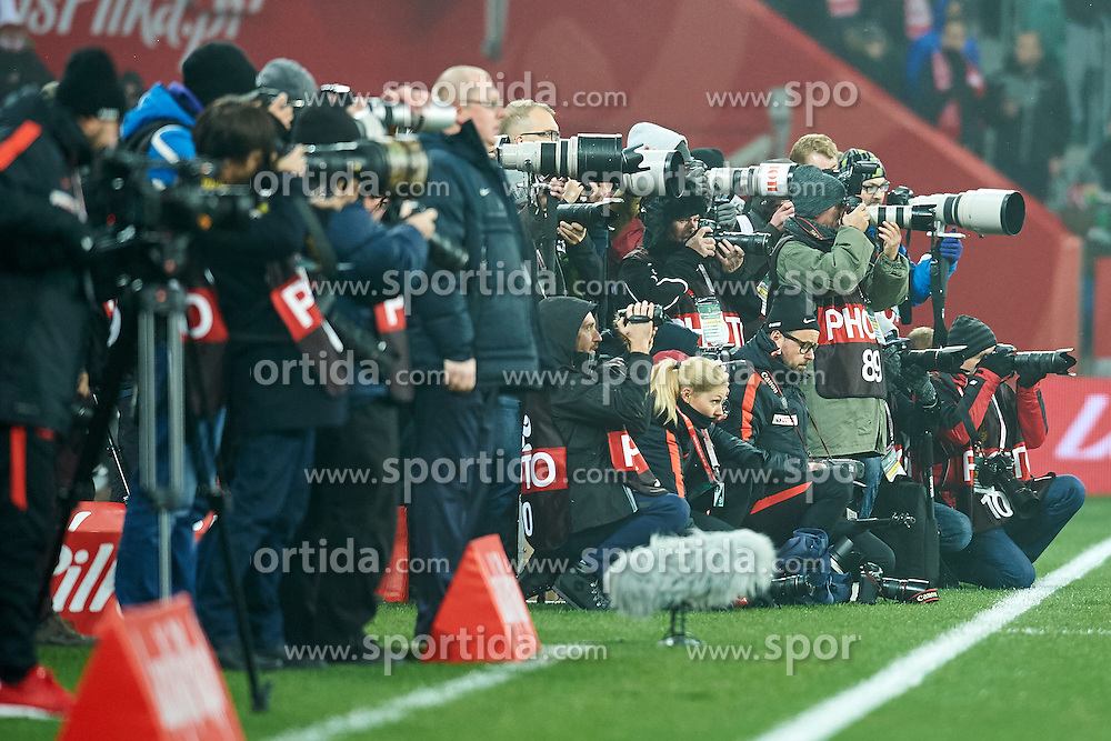 Wroclaw, Poland - 2016 November 14: Photographers shoot pictures during Poland v Slovenia - International Friendly Soccer Match at Municipal Stadium on November 14, 2016 in Wroclaw, Poland.<br /> <br /> Adam Nurkiewicz declares that he has no rights to the image of people at the photographs of his authorship.<br /> <br /> Picture also available in RAW (NEF) or TIFF format on special request.<br /> <br /> Any editorial, commercial or promotional use requires written permission from the author of image.<br /> <br /> Mandatory credit:<br /> Photo by © Adam Nurkiewicz / Mediasport
