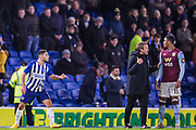 Bjorn Hamberg, First Team Coach of Brighton & Hove Albion FC tries to mediate during the altercation between Neal Maupay (Brighton) & Ezri Konsa (Aston Villa) as both players went to leave the pitch following the final whistle after the Premier League match between Brighton and Hove Albion and Aston Villa at the American Express Community Stadium, Brighton and Hove, England on 18 January 2020.