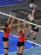 LeMars Gehlen Catholic's Katelin Langel (4) gets the ball over the defenders during their 1A semifinal match in the state volleyball tournament at the U.S. Cellular Center at 370 1st Ave E on Friday evening, November 12, 2010. (Stephen Mally/Freelance)