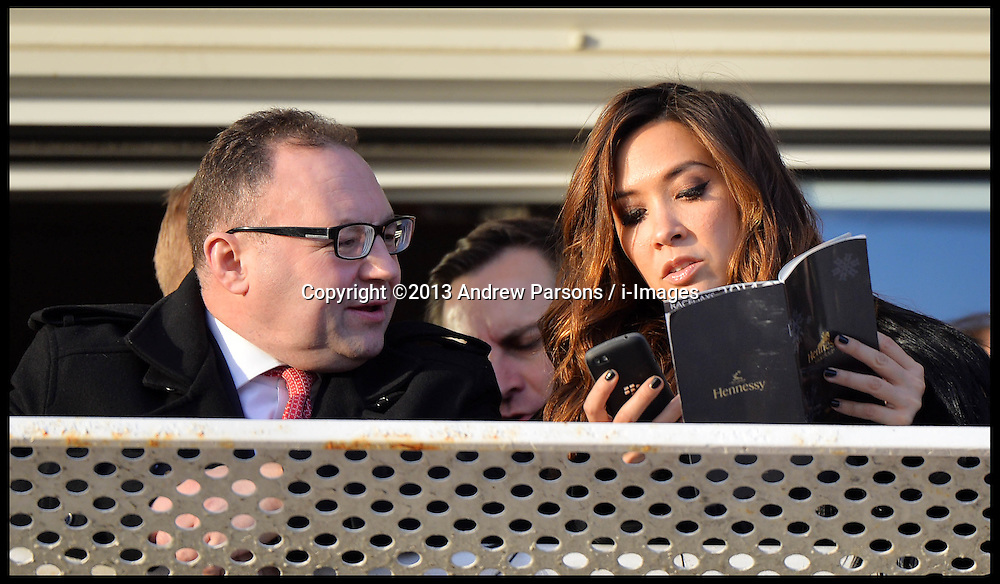 Myleene Klass and her manager JONATHAN SHALIT looks at the race card at the start of the Hennessy Gold Cup at Newbury racecourse in Berkshire, United Kingdom,  Saturday, 30th November 2013. Picture by Andrew Parsons / i-Images<br /> <br /> File Photo - Myleene Klass Angry Tweet<br /> <br /> Myleene Klass vents anger on Twitter after saying her mother and sister were mugged<br /> 'I hope you get hit by a bus and die. slowly.' <br /> Photo filed Friday, 10th January 2014