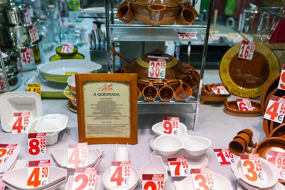 SANTIAGO DE COMPOSTELA, SPAIN - 10th October 2017 - Queimada punch set for sale in a shop window, Santiago de Compostela, Galicia, Spain.